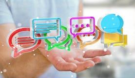 Homem de negócios que usa o ico colorido digital da conversação da rendição 3D Fotografia de Stock