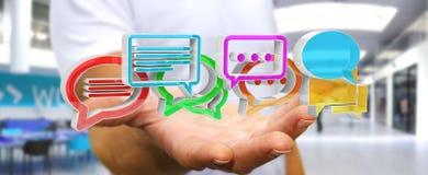 Homem de negócios que usa o ico colorido digital da conversação da rendição 3D Foto de Stock