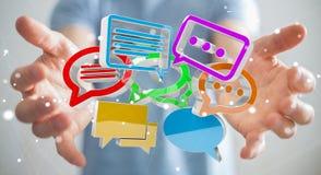 Homem de negócios que usa o ico colorido digital da conversação da rendição 3D Fotos de Stock