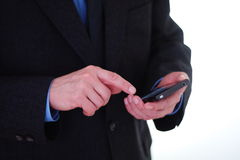 Homem de negócios que usa o smartphone Foto de Stock Royalty Free