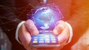 Homem de negócios que usa o smartphone com uma rede conectada sobre uma orelha Imagens de Stock Royalty Free