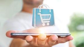 Homem de negócios que usa a rendição digital dos ícones 3D da compra Foto de Stock
