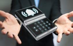 Homem de negócios que usa a rendição home do dispositivo de segurança 3D do alarme Fotografia de Stock