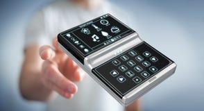 Homem de negócios que usa a rendição home esperta do dispositivo remoto 3D Fotografia de Stock