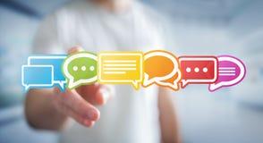 Homem de negócios que usa a rendição lisa colorida dos ícones 3D da conversação Imagens de Stock Royalty Free