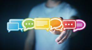 Homem de negócios que usa a rendição lisa colorida dos ícones 3D da conversação Imagem de Stock