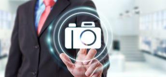 Homem de negócios que usa a rendição moderna da aplicação 3D da câmera Foto de Stock Royalty Free