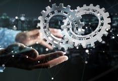 Homem de negócios que usa a rendição moderna de flutuação do mecanismo de engrenagem 3D Imagens de Stock Royalty Free