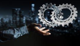Homem de negócios que usa a rendição moderna de flutuação do mecanismo de engrenagem 3D Imagem de Stock Royalty Free
