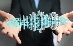 Homem de negócios que usa a rendição moderna de flutuação do mecanismo de engrenagem 3D Imagens de Stock