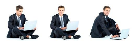Homem de negócios que usa um portátil imagens de stock royalty free