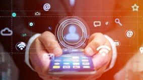 Homem de negócios que usa um smartphone com um ícone do contato que cerca b Imagens de Stock