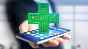 Homem de negócios que usa um smartphone com uma cruz da farmácia da iluminação Fotografia de Stock Royalty Free