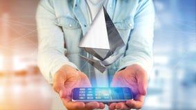 Homem de negócios que usa um smartphone com uma moeda cripto s de Ethereum Fotografia de Stock Royalty Free