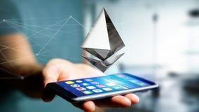 Homem de negócios que usa um smartphone com uma moeda cripto s de Ethereum Fotos de Stock Royalty Free