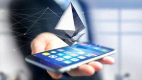 Homem de negócios que usa um smartphone com uma moeda cripto s de Ethereum Foto de Stock