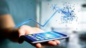 Homem de negócios que usa um smartphone com uma seta financeira que vai acima Fotografia de Stock