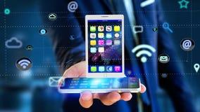 Homem de negócios que usa um smartphone com uma tabuleta que cerca pelo app Foto de Stock Royalty Free