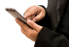 Homem de negócios que usa um telefone esperto, isolado no fundo branco Fotografia de Stock