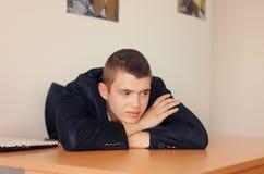 Homem de negócios Resting Head na mesa Fotos de Stock