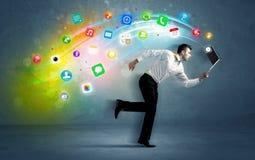 Homem de negócios running com ícones da aplicação do dispositivo Fotografia de Stock