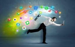 Homem de negócios running com ícones da aplicação do dispositivo Imagens de Stock