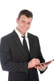Homem de negócios seguro com uma prancheta Fotos de Stock