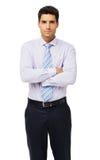 Homem de negócios seguro Standing Arms Crossed Fotografia de Stock Royalty Free