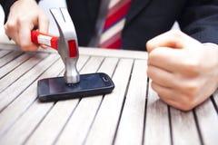 Homem de negócios Smashing Phone Imagens de Stock Royalty Free