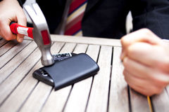 Homem de negócios Smashing Phone fotos de stock royalty free