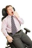 Homem de negócios sonolento furado Foto de Stock Royalty Free