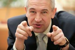 Homem de negócios superior que aponta seus dedos em você Imagens de Stock
