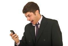 Homem de negócios surpreendido com telefone Fotografia de Stock Royalty Free