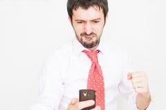 homem de negócios com um telefone Fotografia de Stock