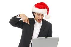 Homem de negócios surpreendido no Natal imagens de stock royalty free
