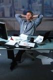 Homem de negócios Tired com papéis toda ao redor Fotos de Stock Royalty Free