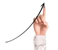 Homem de negócios Touching um gráfico Fotos de Stock Royalty Free