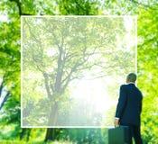 Homem de negócios verde Thinking Conservation Concept do negócio fotografia de stock royalty free