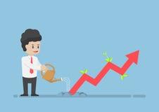 Homem de negócios Watering Business Graph esse crescimento com o Grou Imagem de Stock