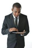 Homem de negócios Working na tabuleta Fotos de Stock