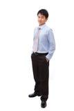 Homem de negócio cheio do comprimento com sorriso confiável Imagem de Stock Royalty Free