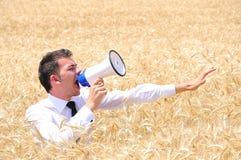 Homem de negócio com altifalante Fotografia de Stock Royalty Free
