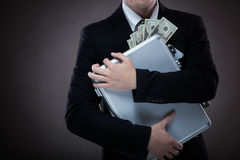 Homem de negócio com a mala de viagem completa do dinheiro Fotos de Stock