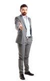 Homem de negócio com uma mão aberta pronta para selar um negócio Fotografia de Stock Royalty Free