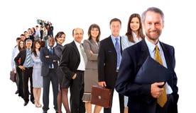 Homem de negócio e sua equipe Foto de Stock