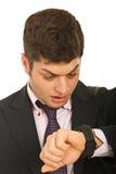 Homem de negócio espantado com relógio Fotografia de Stock Royalty Free