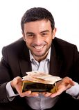 Homem de negócio feliz com uma barra e as cédulas de ouro Imagens de Stock