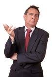 Homem de negócio irritado da Idade Média no terno Foto de Stock
