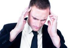 Homem de negócio novo com uma dor principal Imagem de Stock