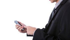 Homem de negócio que guarda o telefone móvel, esperto transparente de vidro Fotografia de Stock
